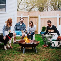 Family gathering in the backyard with fire pit