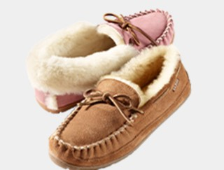 2 shearling-lined slippers, 1 pink and 1 brown.