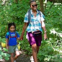 Woman and child hiking outside