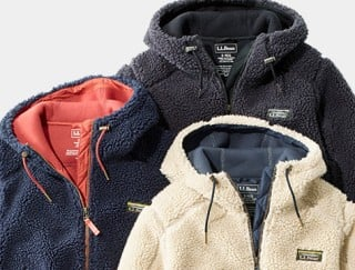 Close-up of 3 hooded fleece jackets.