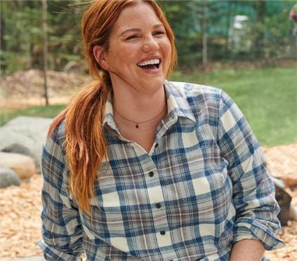 Woman wearing flannel shirt outside