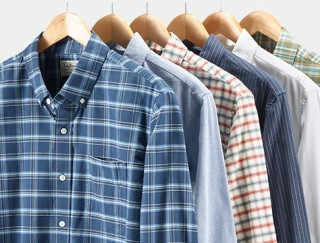 Close-up of 6 shirts on hangers.