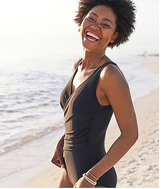 A lady enjoying a day at the beach.