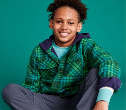 Young boy wearing flannel hoodie
