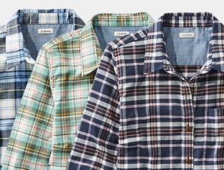Close-up of 3 plaid shirts.